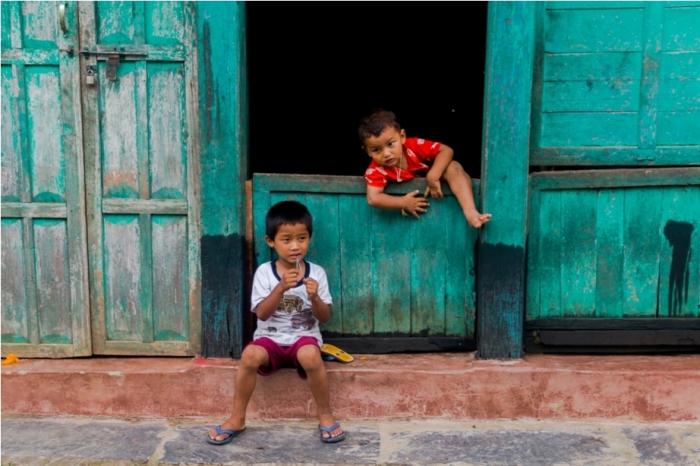 Children kids Khadga Devi Hindu Temple. Heritage area of Offbeat Bandipur, Nepal