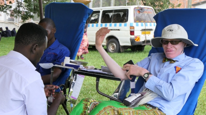 Edmond Wetongola donates blood during IAAD celebrations in Jinja as part of the activities linned up for the day.