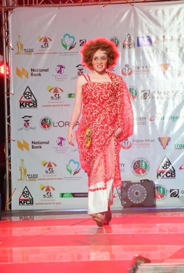 Joan a Ugandan Model with albinism on the run way.