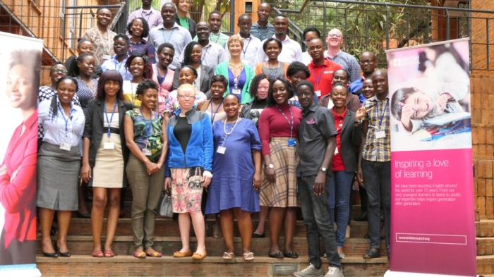 Pat in black shirt post for a picture with staffs of British Council Uganda after making a presentation on the status of persons with albinism in Uganda from a journalistic perspective.